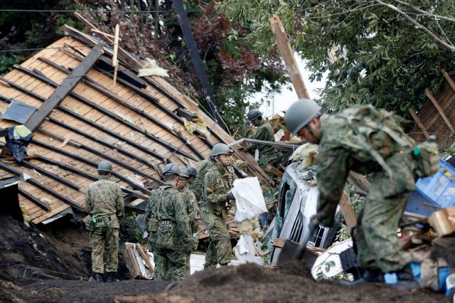 Japan Ground Self-Defense Force personnel search for missing persons at the site of a landslide triggered by Thursday