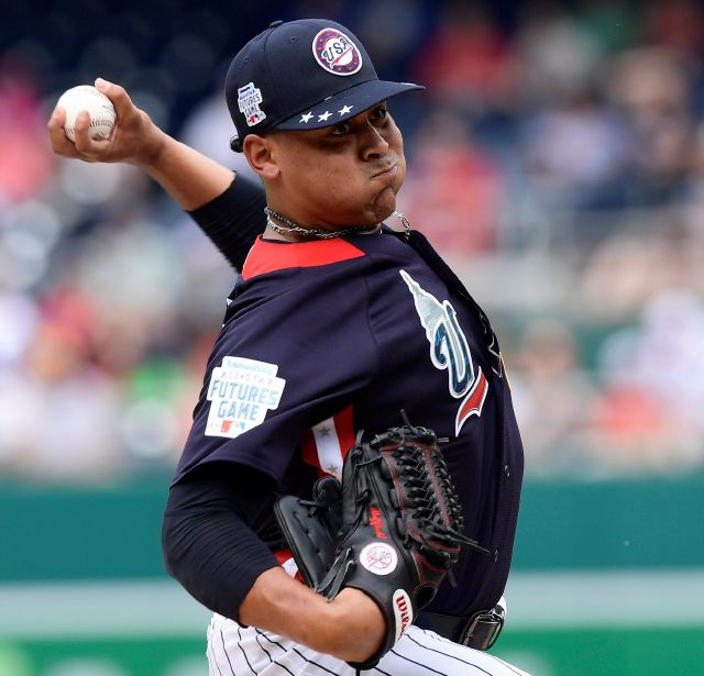 FILE - In this July 15, 2018, file photo, U.S. pitcher Justus Sheffield works against the World Team in the second inning during the All-Star Futures baseball game, at Nationals Park in Washington. Left-hander Justus Sheffield was put on the major league roster by the New York Yankees and could make his major league debut this week. The 22-year-old is nephew of former Yankees outfielder Gary Sheffield. (AP Photo/Susan Walsh, File)
