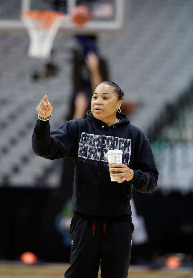 South Carolina head coach Dawn Stanley gives direction to her players during a practice session for the women
