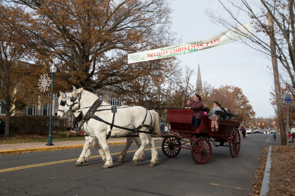 Horse drawn carriage rides were provided by Allegra Farm in East Haddam Saturday during Season of Celebration at the Town Hall in Wallingford December 2, 2017 | Justin Weekes / For the Record-Journal