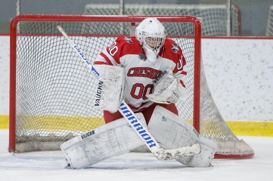 Goalie Nick Maringola and the Cheshire hockey team stayed red-hot Wednesday night, improving to 11-4-1 with a 5-3 victory over Guilford, the top-ranked team in the CIAC Division II points standings. The Rams rank No. 5. | Justin Weekes / Special to the Record-Journal