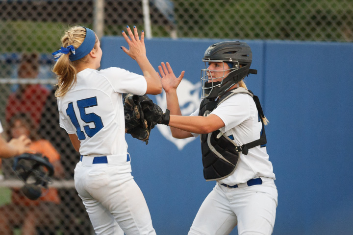 Above: Southington's Kendra Friedt (15) and Rachel Dube (25) high five after getting out of a tough inning Saturday at DeLuca Field in West Haven. Left: Southington's Syndney Ferrante (13) tags out Amity's Michelle Woodruff (4).| Photos by Justin WeekesFor the Record-Journal