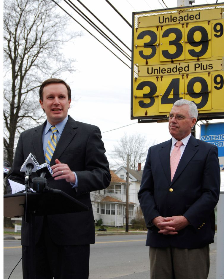 U.S. Rep. Chris Murphy (left) and George McGoldrick (right), hold a press conference in Meriden on Friday April 11, 2008, asking President Bush to lower gas prices. (Holly Bouchard Smith/for the Record-Journal)