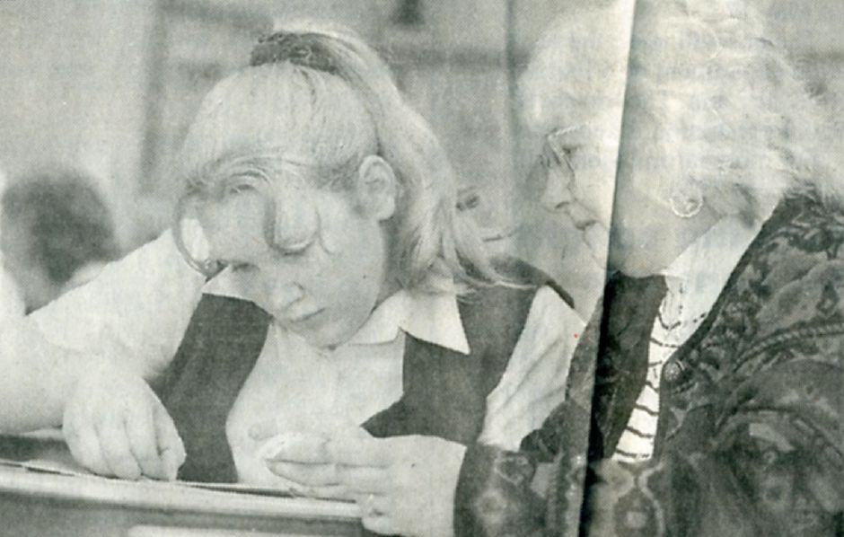 Valerie Cousino watches her granddaughter Shannon decorate a paper picture frame at Our Lady of Mount Carmel School, May 1997.