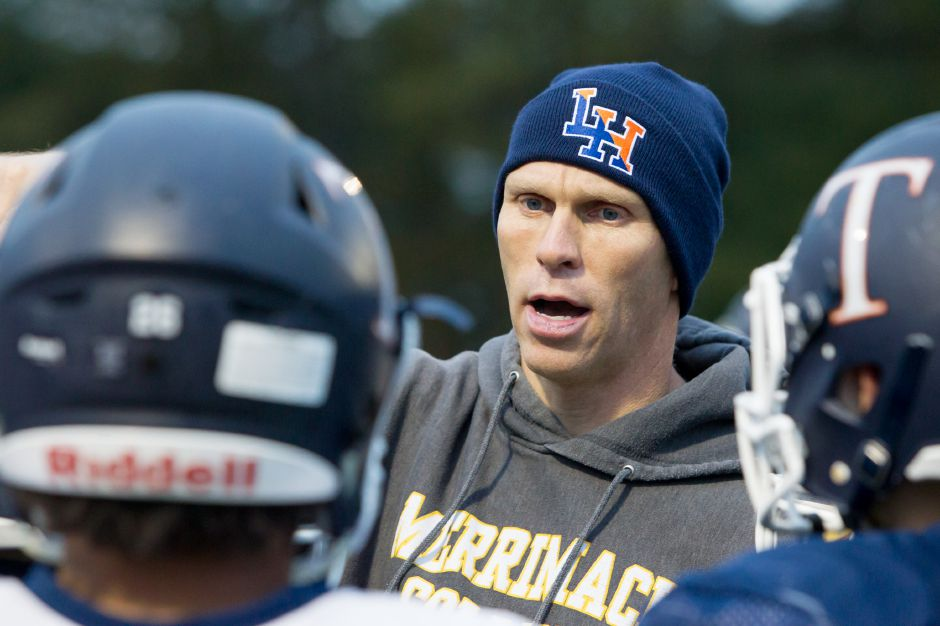 Lyman Hall head coach Bill Weyrauch speaks with his players Tuesday as the Trojans prepare for rival Sheehan in Thursday's  Carini Bowl. Justin Weekes, Special to the Record-Journall