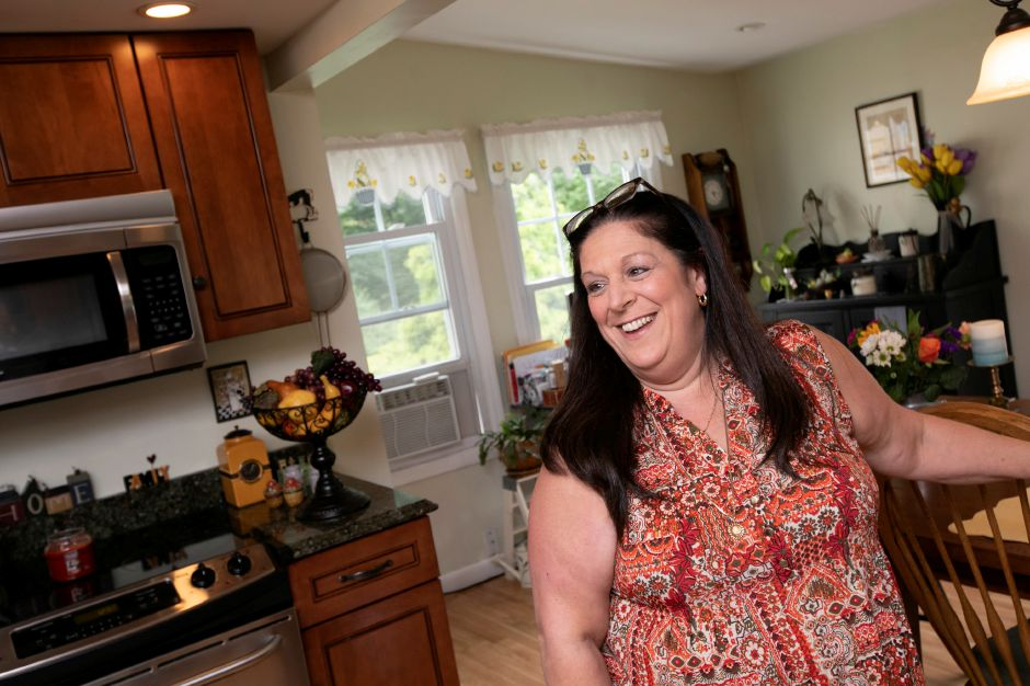 Angela Massimino, of Cheshire, is the creator of Angela's Kitchen meat sauce. Photos by Dave Zajac, Record-Journal