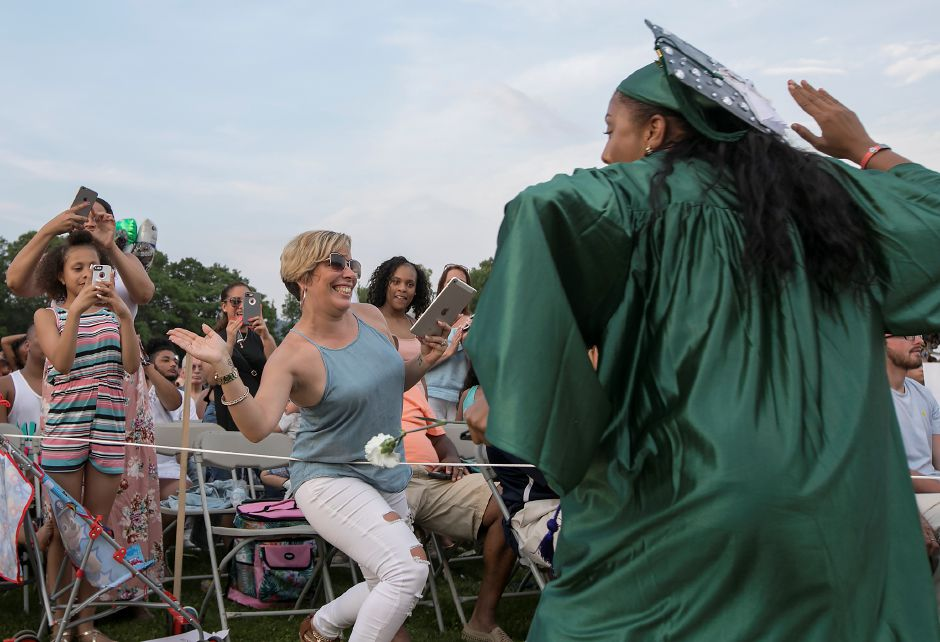 "Graduate Erionne Shields sets up for a ""high-five"" with mother, Jamie, after receiving her diploma during graduation ceremonies at Maloney High School in Meriden, Tuesday, June 13, 2017. 