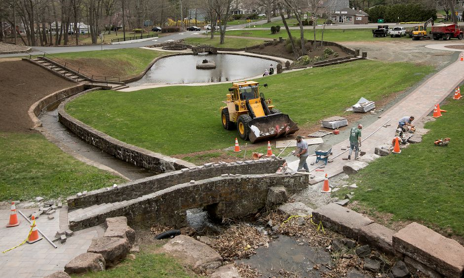 Workers build a new walkway in preparation for the annual Daffodil Festival at Hubbard Park in Meriden, Monday, April 17, 2017. | Dave Zajac, Record-Journal