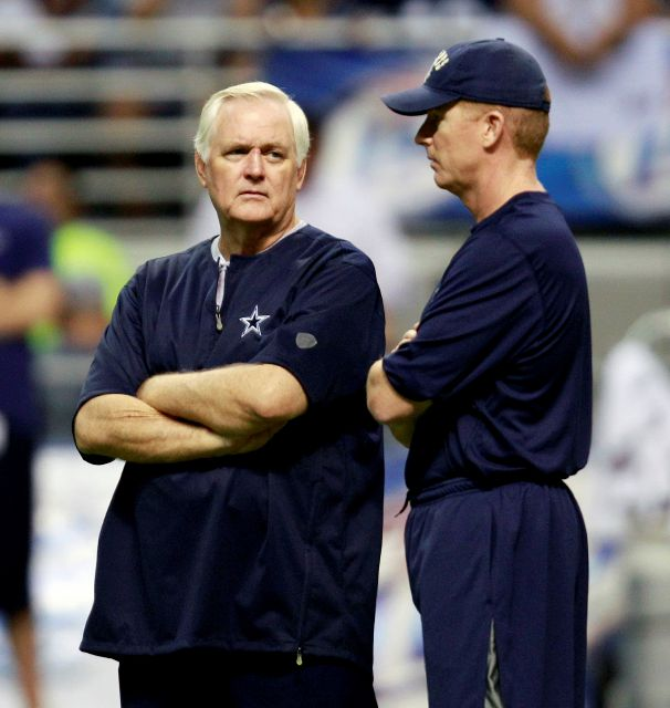 FILE - In this Aug. 2, 2010, file photo, then-Dallas Cowboys head coach Wade Phillips, left, and then-offensive coordinator Jason Garrett chat during the team