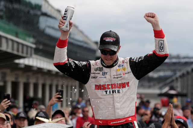 NASCAR Cup Series driver Brad Keselowski (2) celebrates after winning the NASCAR Brickyard 400 auto race at Indianapolis Motor Speedway, in Indianapolis Monday, Sept. 10, 2018. (AP Photo/Michael Conroy)
