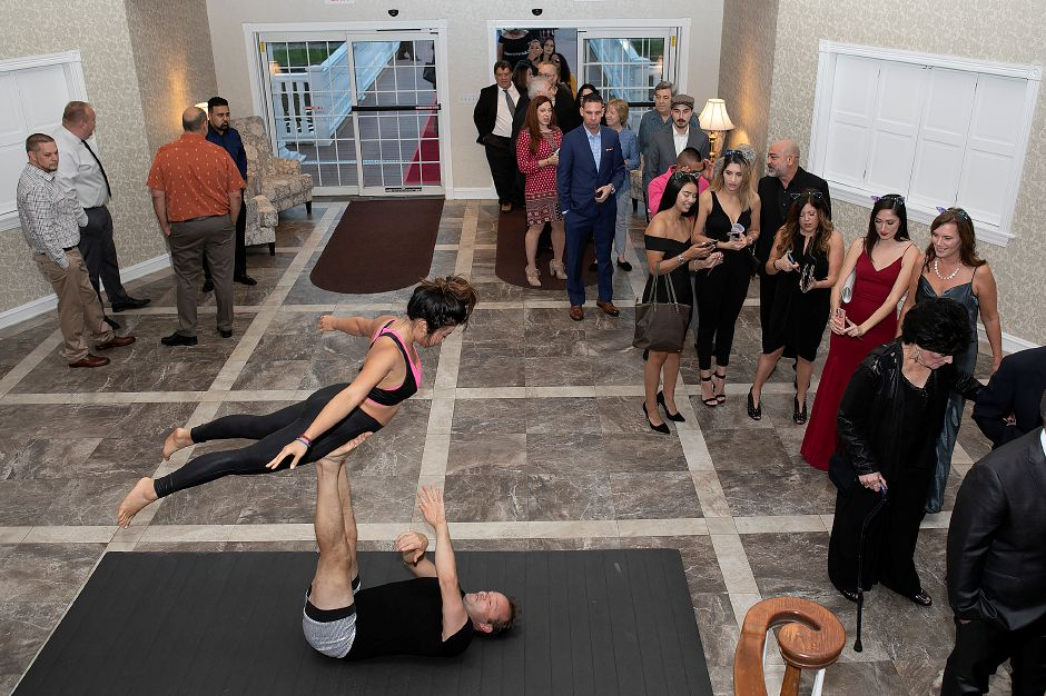 AcroYoga performers provide entertainment for guests arriving at the inaugural Record-Journal Reader