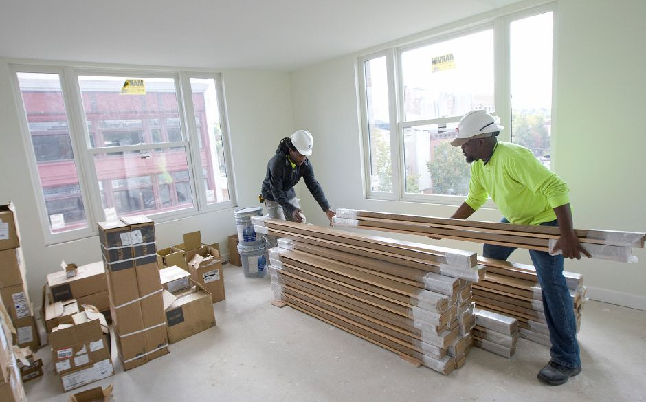 Workers Jason Altius, left, and Rick Altius, of Wall Systems Inc., stack window sills in an apartment overlooking Colony Street at the new mixed-use building at 24 Colony St. in Meriden, Monday, October 3, 2016. Ten days after it began accepting applications for housing units at 24 Colony St., the Meriden Housing Authority had 5,800 tenants eager to move in, according to Executive Director Robert Cappelletti. | Dave Zajac, Record-Journal