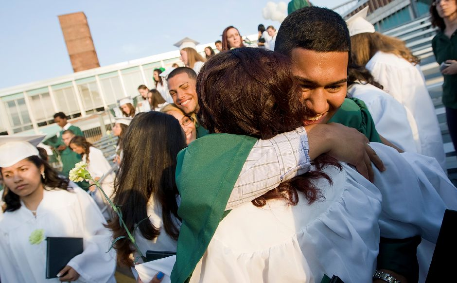 Graduates Erik Munoz and Yohanna Harvey embrace at the conclusion of commencement ceremonies at Maloney High School, Friday, June 21, 2013. (Dave Zajac/Record-Journal)