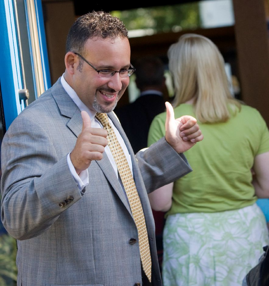 The school year is underway as Principal Miguel Cardona gives the thumbs up to students entering Hanover Elementary Wednesday morning August 31, 2011. (Dave Zajac/Record-Journal)
