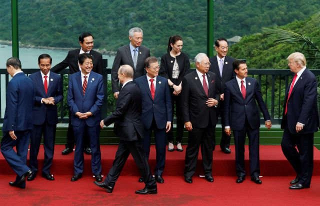 Leaders attend the family photo session at the APEC Summit in Danang, Vietnam, Saturday, Nov. 11, 2017. Top left to right; Thailand