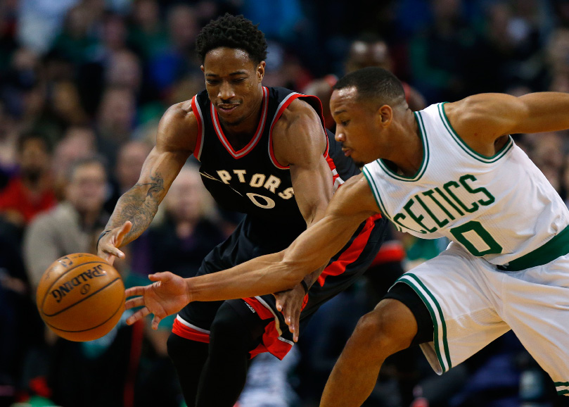 Boston Celtics guard Avery Bradley strips the ball from Toronto Raptors