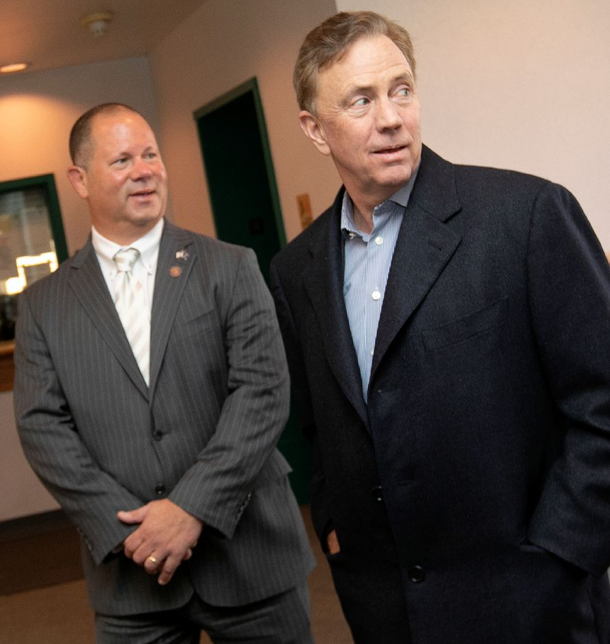 Gov. Ned Lamont, right, and Town Councilor Craig Fishbein visit the police station during a tour of Wallingford, in February. Dave Zajac, Record-Journal
