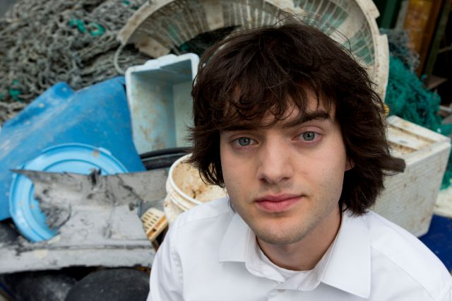 FILE - In this May 11, 2017, file photo, Dutch innovator Boyan Slat poses for a portrait next to a pile of plastic garbage prior to a press conference in Utrecht, Netherlands. Engineers will deploy a trash collection device to corral plastic litter floating between California and Hawaii in an attempt to clean up the world