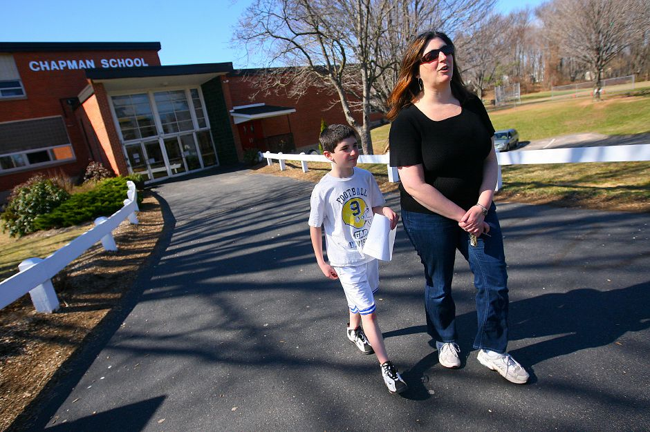 Amy Cillie, walks with her son Ben Cillie, a 9 year old 3rd grader at Chapman School in Cheshire on Thursday March 18, 2010. (Johnathon Henninger/ Record-Journal)