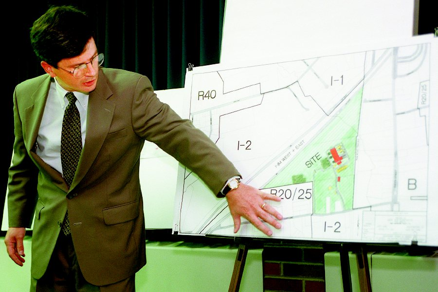 Joseph Cleary, of AES Enterprises, refers to a site map during an Aug. 25, 1998, presentation to town officials in Southington for a commercial power generating plant.