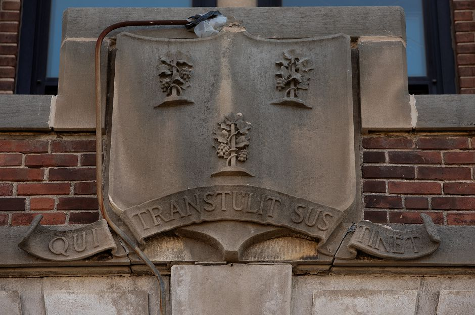 The Coat of Arms and state motto of Connecticut QUI TRANSTULIT SUSTINET (He Who Transplanted Still Sustains) remains on the former armory on East Main Street, Wednesday, July 18, 2018. Work on the Trail of Terror