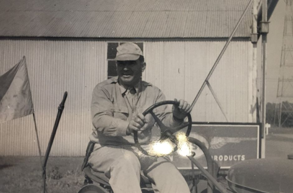 Ernest L. Markham, on a tractor at the Meriden Municipal Airport. | Photo Courtesy Linda Scialabba