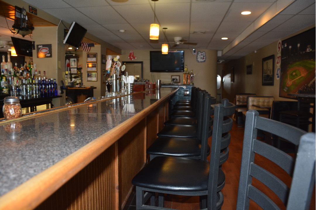 The indoor bar section of Cheshire Pizza located at 133 Highland Ave. | Ariana D