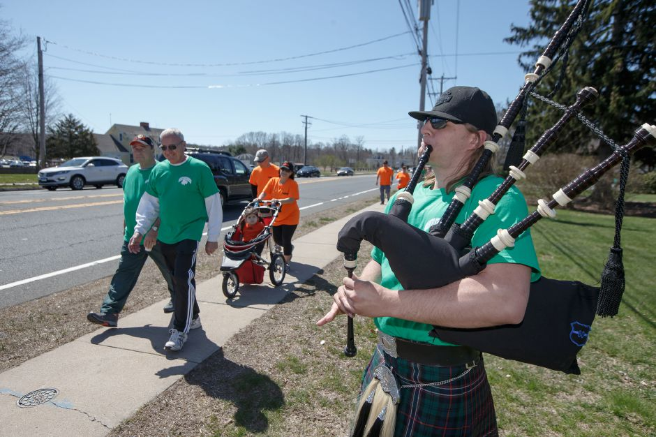 Shaun Roberts, of Waterbury, plays the bagpipes for his team members, Sully