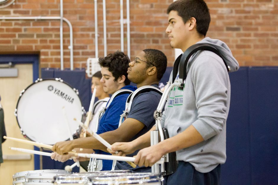 Tyler Tarducci left Jared Burgess and Julio Hernandez keep time on drums Wednesday during the Platt Pep Rally at Platt High School in Meriden November 22, 2017 | Justin Weekes / For the Record-Journal