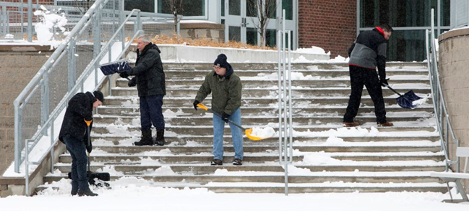 Custodial crews clear a stairway at Maloney High School in Meriden, Wednesday, Jan. 17, 2018. About two inches of snow accumulated in the area. Dave Zajac, Record-Journal