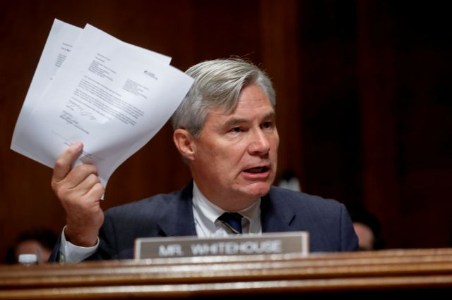 Sen. Sheldon Whitehouse, D-R.I., holds up documents as he speaks at a Senate Judiciary Committee meeting, Friday, Sept. 28, 2018 on Capitol Hill in Washington (AP Photo/Pablo Martinez Monsivais)