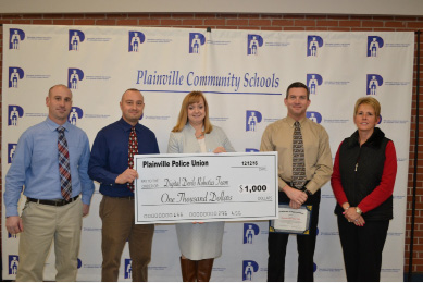 From left: Plainville High School faculty member Mark Chase, faculty member David Gaignard, Superintendent of Schools Dr. Maureen Brummett, Detective David Posadas, and Plainville Board of Education Chair Andrea Saunders.