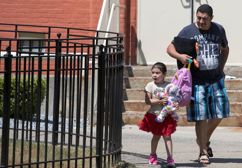 Martin Torres picks up daughter Angela, 4, at the Women and Families Center in Meriden on Thursday. Funding for the School Readiness Program will end  August 24. Dave Zajac, Record-Journal
