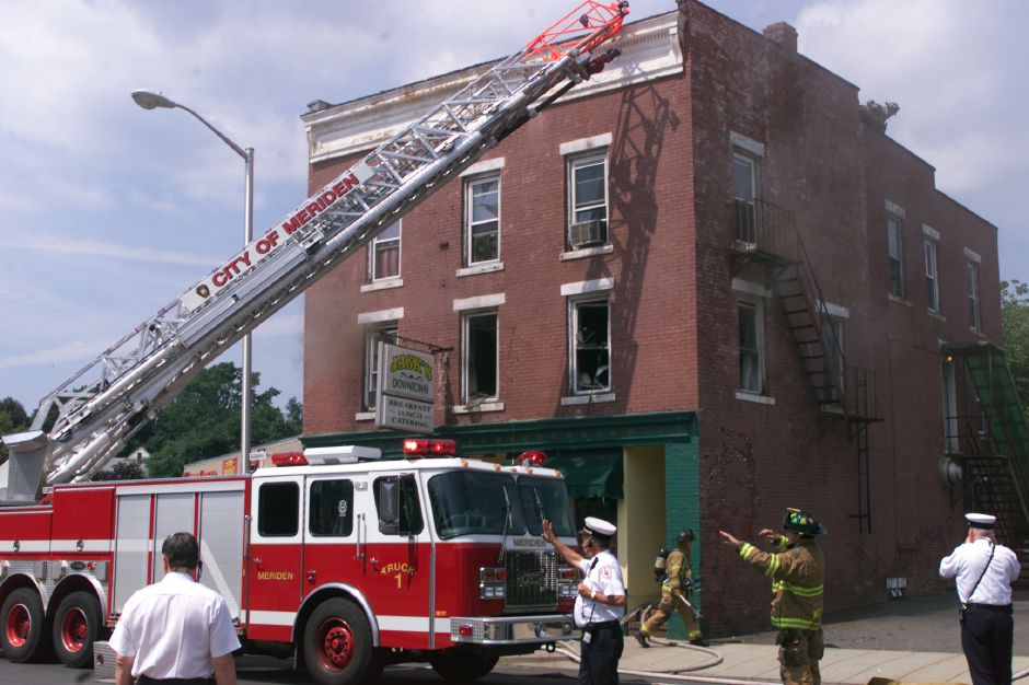 Meriden firefighters on the scene of a fire on the second floor above Jack's Downtown restaurant on Hanover Street in Meriden Thursday afternoon.