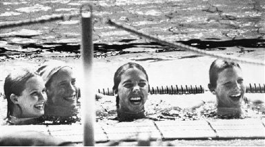 American's Sandra Neilson, Jane Barkman, Jennifer Kemp and Shirley Babashoff grin at poolside after they broke the world record in the 400-meter freestyle relay at the Olympic Games in Munich, Germany on August 30, 1972. (AP Photo/Peter Winterbach)