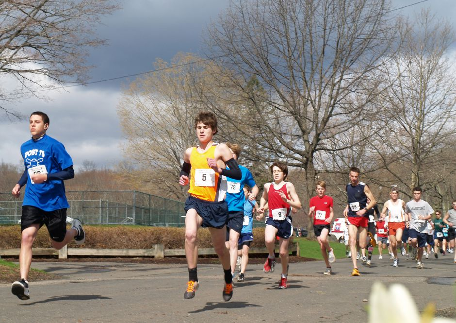 FILE – Zach Anderson, 15, center, of New Fairfield, leads the pack early during the Meriden Rotary Club Annual 5K Road Race and Fun Run Sunday morning in Hubbard Park. Anderson went on to finish first in the race. (Richie Rathsack/Record-Journal)