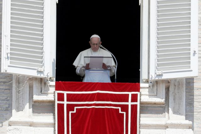 FILE - In this Sunday, Aug. 19, 2018 file photo, Pope Francis prays for the victims of the Kerala floods during the Angelus noon prayer in St.Peter