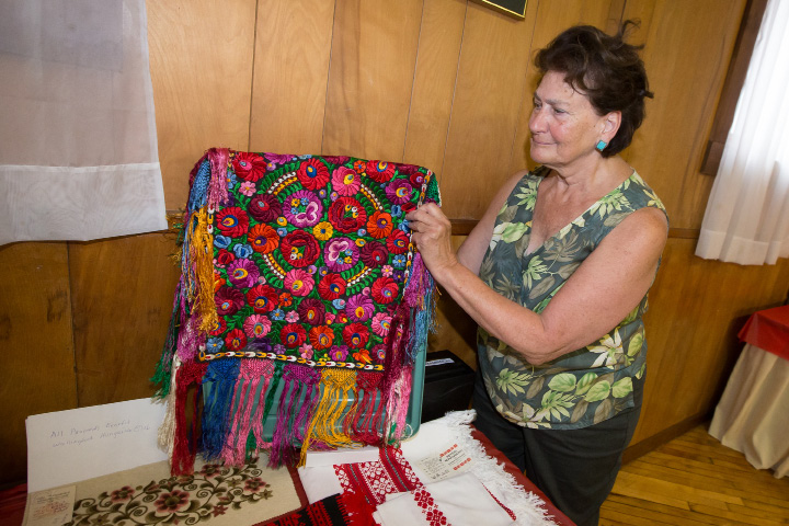 Susan Bullock of Tolland Mass hold a traditional Hungarian matyo embroidery on display Sunday during the Hungarian Festival at the Hungarian Community Club in Wallingford Sep. 18, 2016 | Justin Weekes / For the Record-Journal