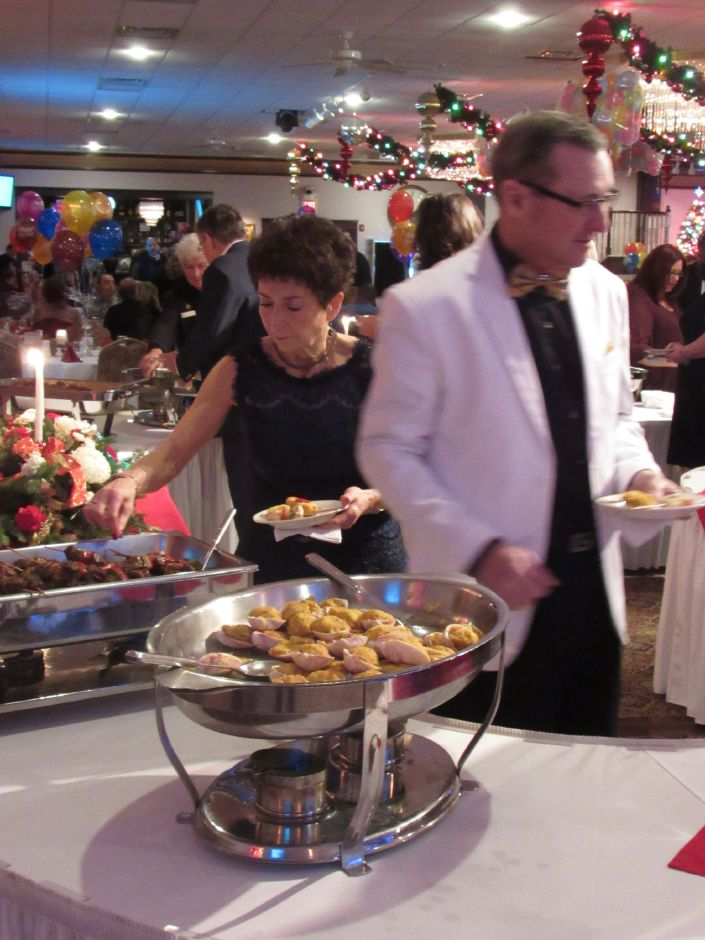 Guests help themselves to hors d'oeuvres at a New Years Eve party at Zandri's Stillwood Inn in Wallingford on Sunday, Dec. 31, 2017. | Lauren Takores, Record-Journal