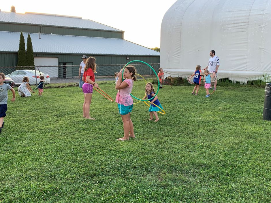 Kids were able to spend the evening playing on the grass while families sat, ate and listened to the music. Photo by Everett Bishop, Town Times.