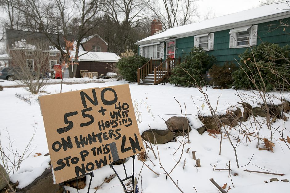 A sign posted in the front yard of a Wonx Spring Road resident against a proposed development off Hunters Lane in Southington, Monday, Dec. 18, 2017. Dave Zajac, Record-Journal