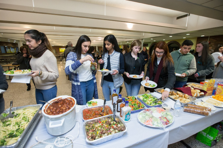 Costa Rican exchange students and their hosts get to know each other Thursday during welcoming dinner for Costa Rican exchange students at Southington High School in Southington.Dec. 29, 2016 | Justin Weekes / For the Record-Journal