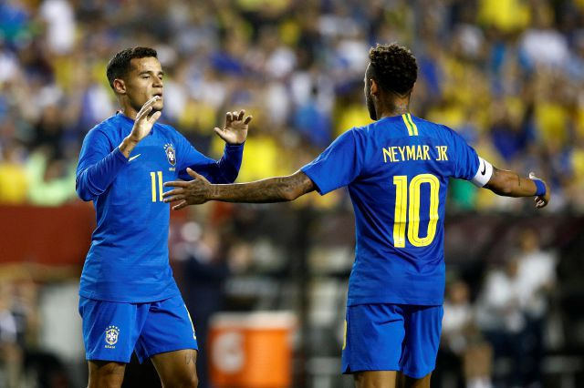 Brazil forward Philippe Coutinho, left, celebrates his goal with teammate Neymar in the first half of a soccer match against El Salvador, Tuesday, Sept. 11, 2018, in Landover, Md. (AP Photo/Patrick Semansky)