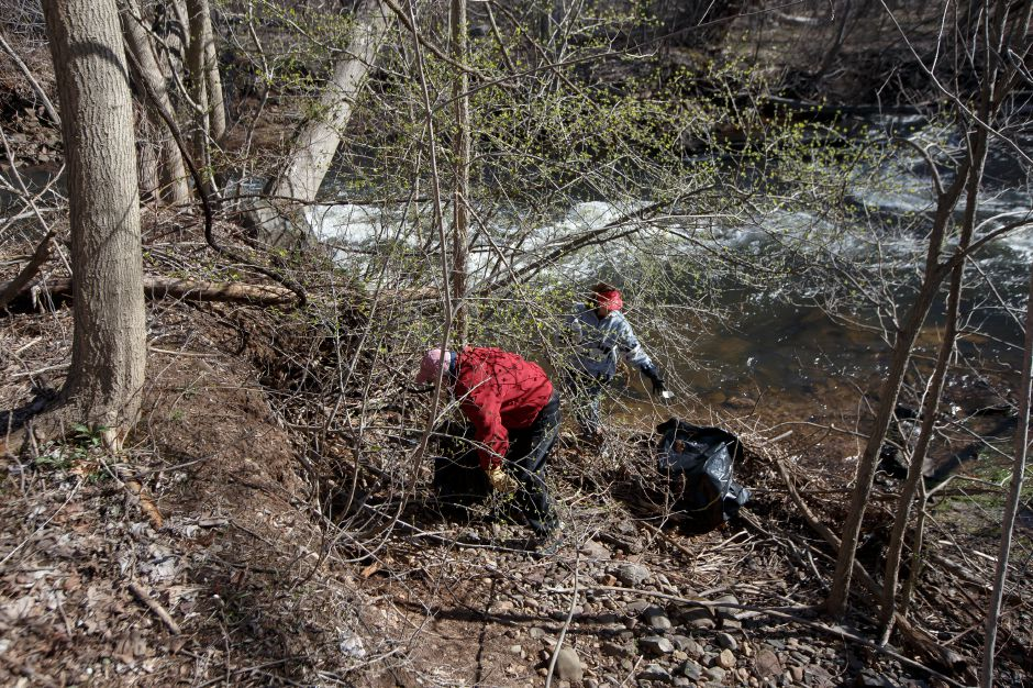 Dick and Gail Leamon of Cheshire look for trash along the river bank Saturday during the Quinnipiac River Watershed Association Spring Source to Sound River Cleanup at Westbrook Lobster in Wallingford April 21, 2018 | Justin Weekes / Special to the Record-Journal
