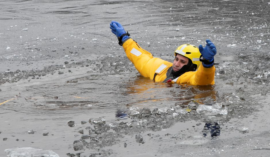 Southington firefighter Daniel Comen plays the victim during the cold water rescue exercise.