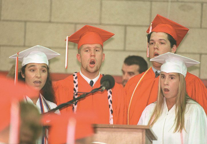 "RJ file photo - Members of the Chehsire High School ""Senior VIPs"" sing the national anthem June 16, 1998."