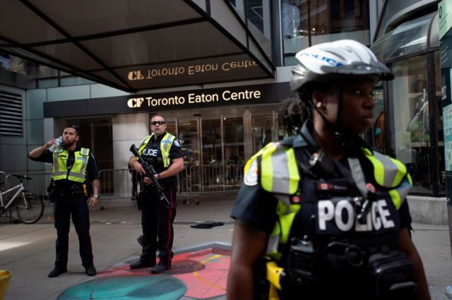 Toronto Police secure the scene where shots were fired during the Toronto Raptors NBA basketball championship parade in Toronto, Monday, June 17, 2019. (Andrew Lahodynskyj/The Canadian Press via AP)