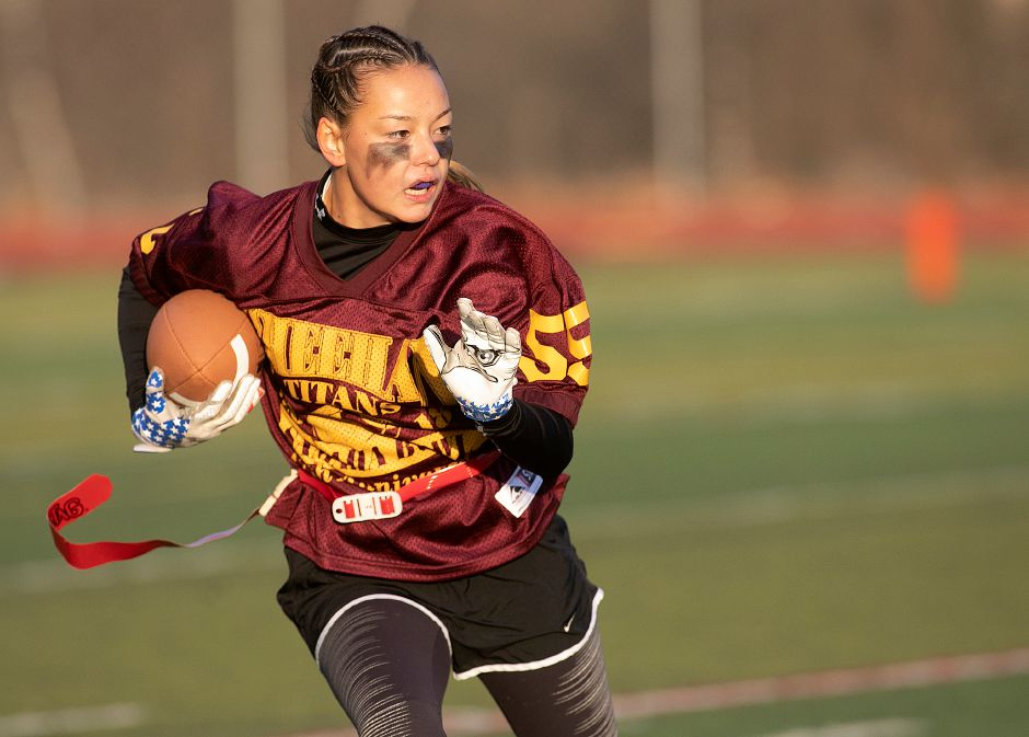 Sheehan captain Caroline Sabo takes the ball on a run play during the first half of the annual Samaha Bowl at Sheehan High School in Wallingford, Wednesday, Nov. 21, 2018. Dave Zajac, Record-Journal