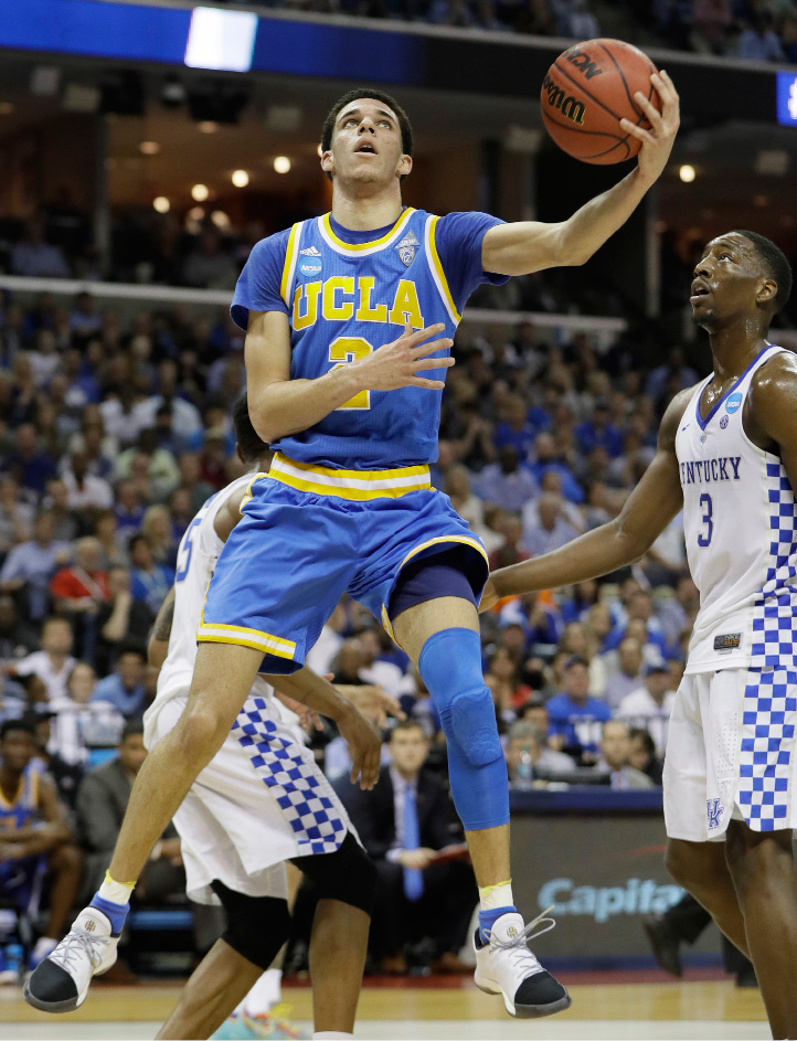 UCLA guard Lonzo Ball shoots the ball against Kentucky in the second half of an NCAA college basketball tournament South Regional semifinal game Friday, March 24, 2017, in Memphis, Tenn. (AP Photo/Mark Humphrey)