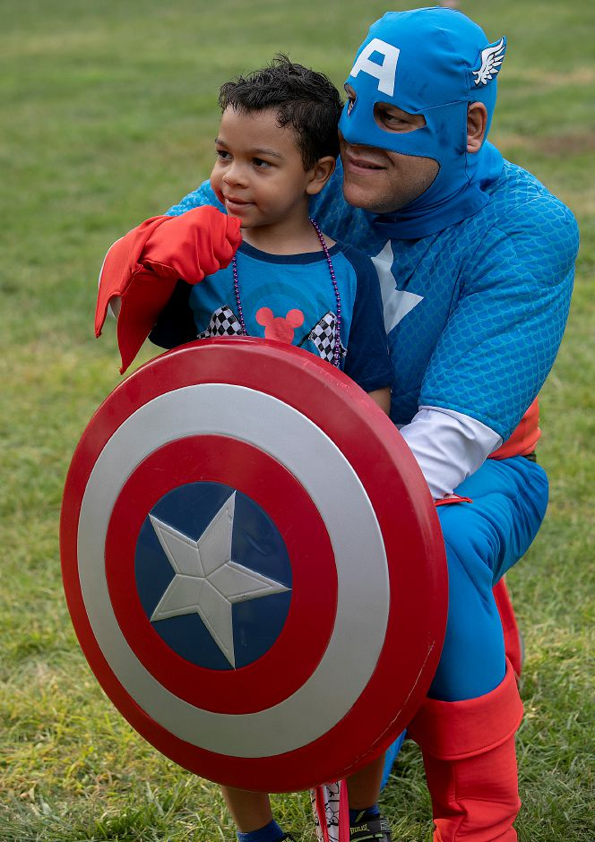 Emmanuel Richards, 6, of Meriden, poses for a photo with Captain America played by Chris Rutledge of Torrington, during the 14th annual National Night Out at Hubbard Park in Meriden, Tuesday, August 7, 2018. Dave Zajac, Record-Journal